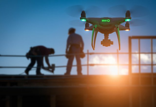 Silhouette of Unmanned Aircraft System Drone (UAV) Quadcopter Dr
