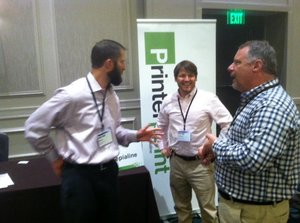 (l to r) Steve Sogan and Michael Jacobs of Sepialine discuss profit-making ideas with Clint Murchison of Hub City Blueprint at the 2015 ERA/IRgA Convention in Atlanta.